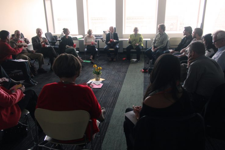 participants of vernissage health gathered in a circle for discussion