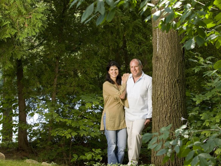 Profile of Paul and Alessandra Dalla Lana with trees and foliage in the background