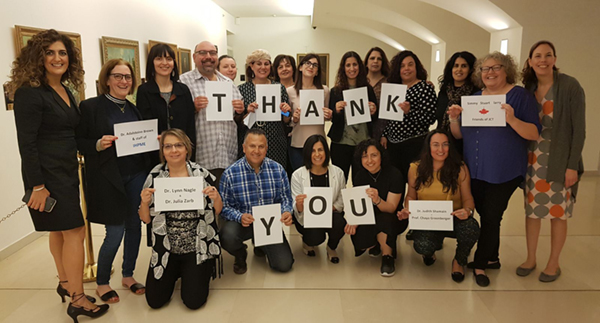 Nurses from JCT holding thank you notes for IHPME and U of T faculty