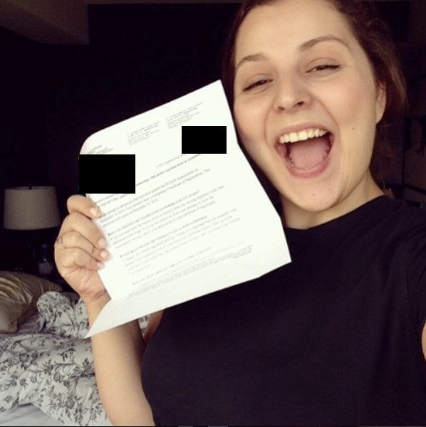 Image of Allie May, author holding NCLEX results