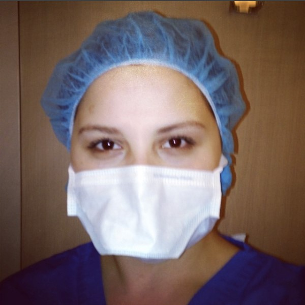 Allie May, author in scrubs and face mask