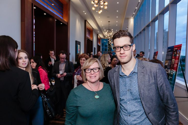 Michael Lebenbaum right with Wendy Neslon left of Vernissage Health at the IHPME Moonshot 2017 celebration. Additional attendees in background