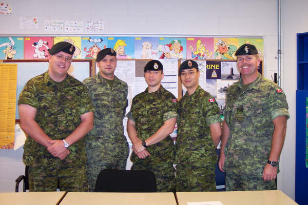 Andrew Lo second from right in camouflage uniform, with military colleagues