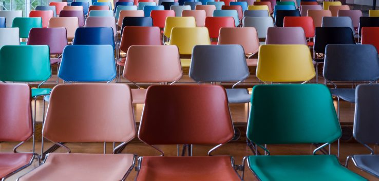 Rows of colorful chairs in Auditorium