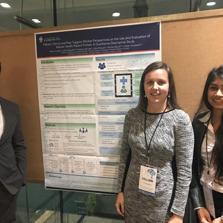 Kevin Leung, Gillian Studwick and Lydia Sequeria stand in front of poster board presentation at Technology in Psychiatry Summit