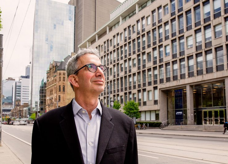 Profile of Robert Schwartz on College Street with Health Sciences Building in background