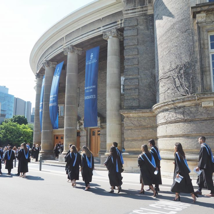 Graduating students in procession in front of U of T's Simcoe Hall