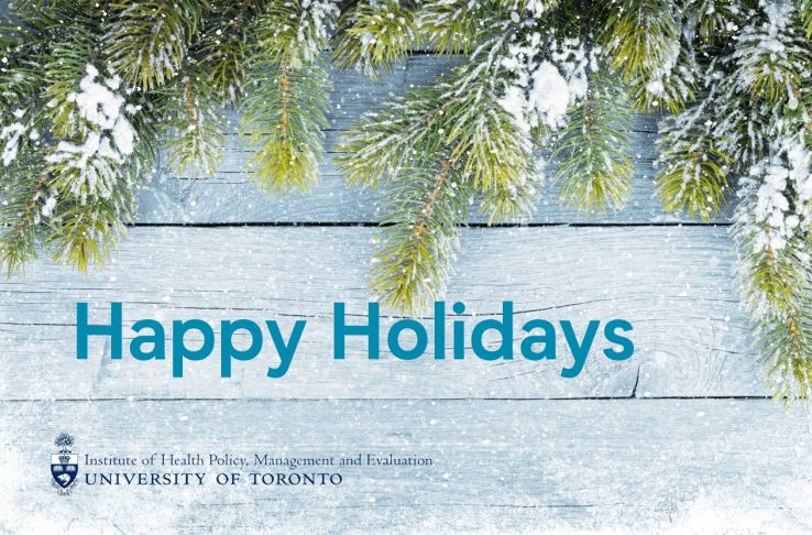 Snow covered evergreen leaves with words Happy Holidays in blue and IHPME logo below