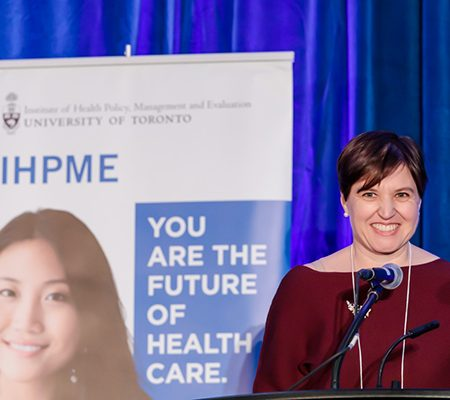 Audrey Laporte speaking with IHPME sign